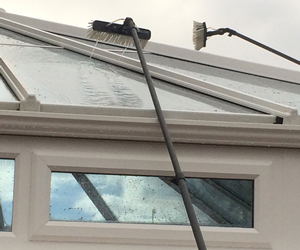 a conservatory roof sprayed with water